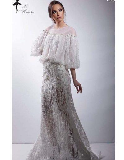 Vestido de novia cuerpo abullonado y transparencias